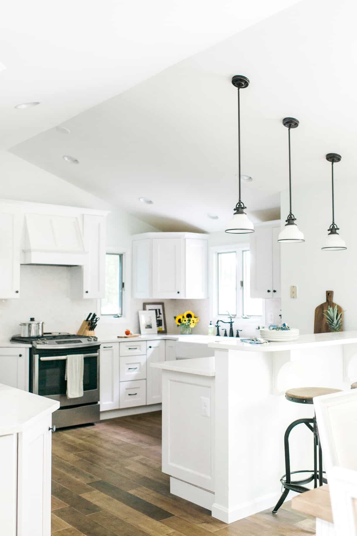 coastal kitchen design.  Coastal inspired kitchen renovation in Annapolis Maryland by branding designers Davey Krista Jones Kitchen Design White Cabinets