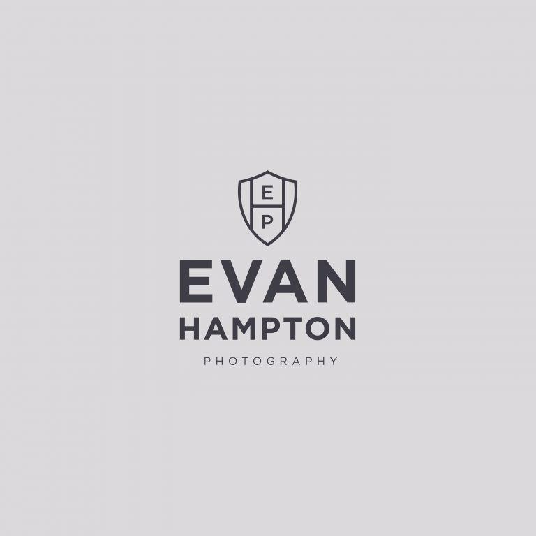 Masculine crest logo design for photographer Evan Hampton by Davey & Krista